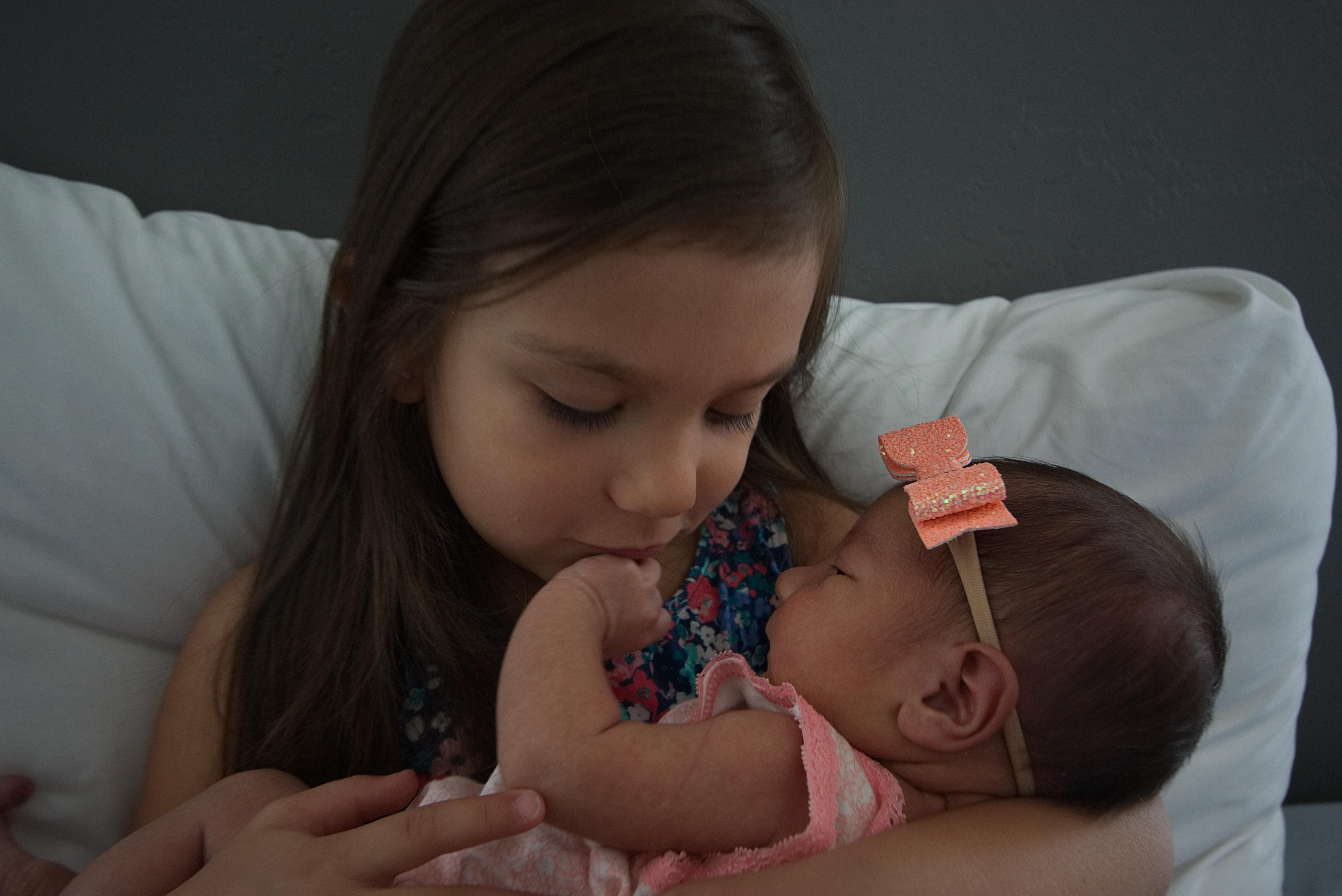 Emilia Jane Newborn Photos on Onyx and Blush