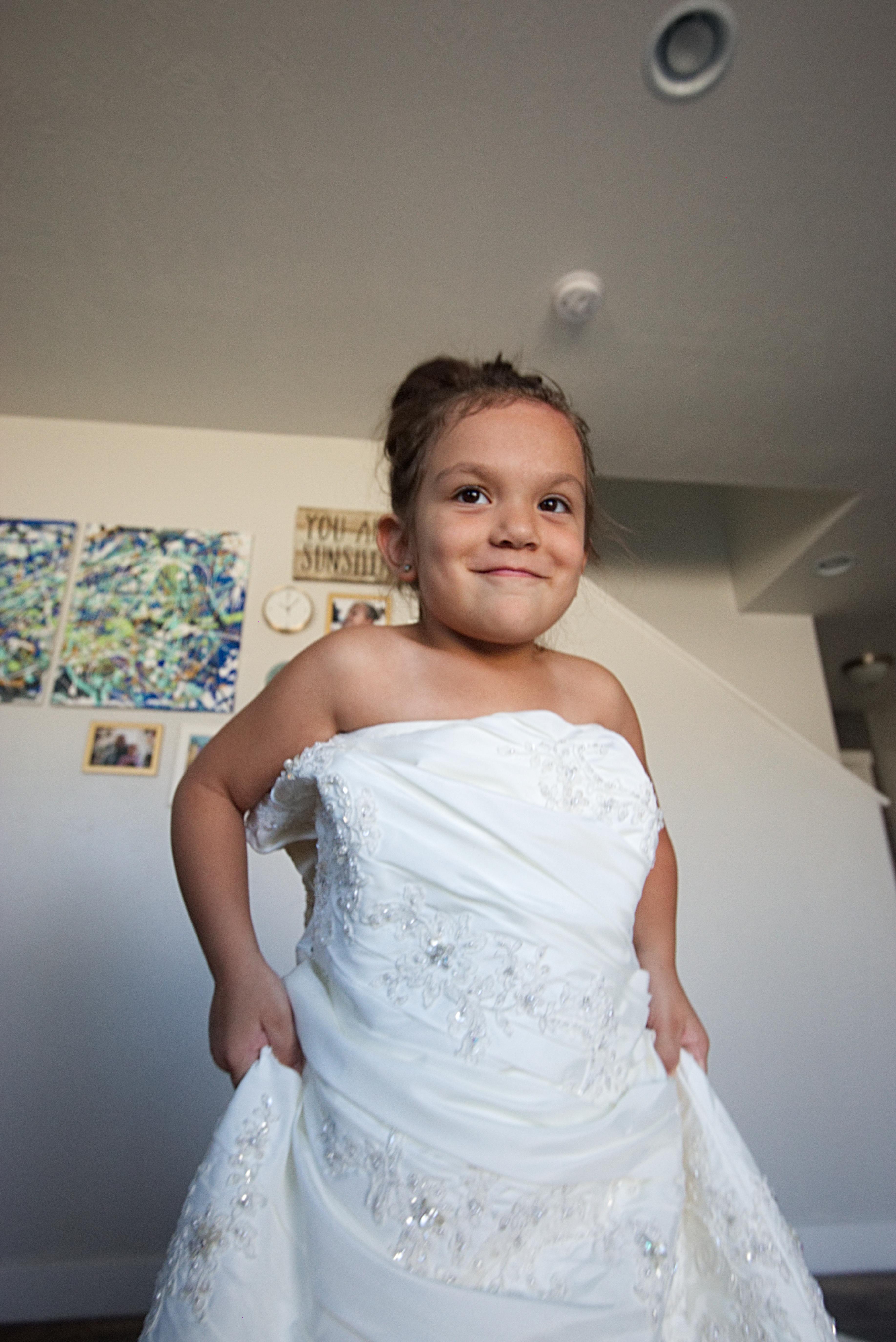 Girl in Moms Wedding Dress